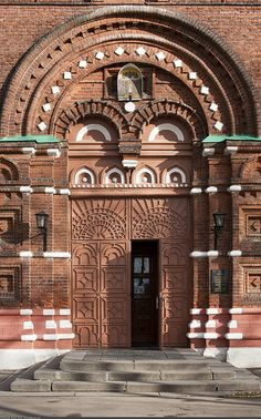 Church of the Holy Virgin  Large #red-brick five-domed church in the pseudo-hip style with a bell tower.