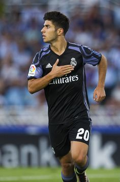 Marco Asensio Photos Photos - Marco Asensio of Real Madrid celebrates after scoring his team's second goal during the La Liga match between Real Sociedad de Futbol and Real Madrid at Estadio Anoeta on August 21, 2016 in San Sebastian, Spain. - Real Sociedad de Futbol v Real Madrid CF - La Liga