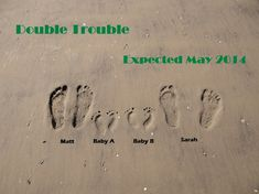 Our twins announcement! The baby feet were made using the side of my hands.