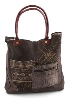 Tribal Patch tote is decorated with unique tribal patterns on up-cycled stone-washed black canvas. It features two pockets on the front of the bag, one slip pocket and one zippered. The Tribal Patch t