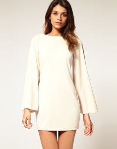 Love this winter white dress would look great with black opaque tights and chunky heels or boots!
