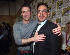 """Chris Evans and Robert Downey Jr. pose at a press line for """"Avengers: Age of Ultron"""" during the 2014 Comic-Con International Convention in San Diego, Calif., on July 26, 2014."""