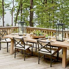 Lake House Decorating Ideas: Set a Rustic Table Pair a wood table with iron chairs for rustic lakeside dining. Fill hurricanes with river rocks and pillar candles of varying height for a touch of elegance. Outdoor Rooms, Outdoor Dining, Outdoor Decor, Outdoor Tables, Farm Tables, Wood Tables, Rustic Outdoor, Dining Tables, Side Tables