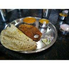 Another one from the #malwan #trip A seafood thali. A thali is a complete meal with variety of textures,flavors and colors that engage ur senses jus like everything else in India does:) This one has kingfish fry,fish curry,a coconut based curry sauce,flatbread chapati ,salad and kokum,carrom seed flavored coconutmilk drink-solkadi  #seafood  #indianfoods #thali  #meal  #nutrition #healthy  #rustic #travel #roadtrip #coastal