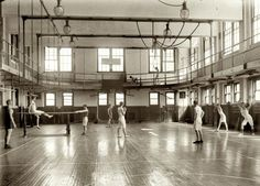 "GYMNASTICS: ""Gym Rats: 1920"" in the YMCA gymnasium in Washington, D.C. Notice the indoor track (balcony). This is a common feature in such gymnasiums."