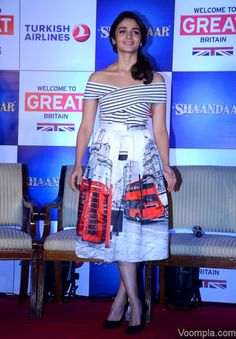Alia Bhatt wearing an Oh London pleated midi skirt paired with a wrap top, both by Chicwish - styled by Ami Patel. via Voompla.com
