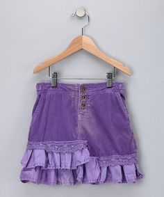 This distinctive skirt will weather every fashion monsoon with laid-back class. A buttoned waist and soft, sumptuous fabric make it a perfect style staple. Frayed hems provide a final touch of elegance.