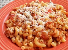 Beef & Roni  Ingredients: 1 lb lean ground beef 1 (15 ounce) can diced tomatoes 1⁄2 cup onion (chopped) 2 garlic cloves (minced) 8 ounces tomato sauce (1/2 can) 3⁄4 cup parmesan cheese (more if you like cheese like we do) 2 1⁄2 cups elbow macaroni (dried)