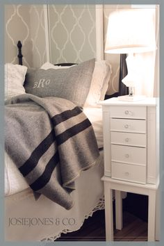 Love the wall stencil and the grey and white bedding