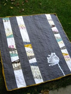 hand quilted from lovelaughquilt- like this idea but with different colors and a bird instead of the flower?