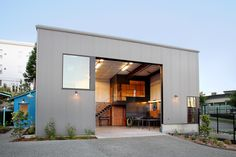 """leibal: """" Rainier Annex Studios is a minimalist space located in Seattle, Washington, designed by Best Practice Architecture and Design. The design is a multi-phase project that converted an old gas station in an artist's studio. Tropical Architecture, Minimalist Architecture, Factory Architecture, Architecture Design, Backyard Office, Warehouse Design, Warehouse Conversion, Modern Garage, Container House Design"""