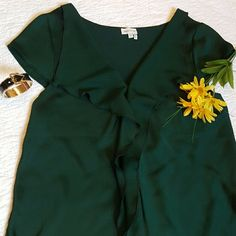 """Emerald top Meadow Rue 39""""bust 26.5""""length Back panel is 94% rayon and 6% spandex Front is 100%polyester Front side has texture and sheen look and back side is smooth and very soft. Hand wash. 2nd and 4th pic are just to show what the materials look like. Anthropologie Tops Blouses"""