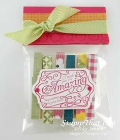 Cute little clips covered with Gingham Garden DSP or try WASHI tape .They are for holding a chip bag closed or hanging a picture or handmade card.You could put a magnet on the back & hang on refrigerator. The tag on the outside was made with the Lovely Romance Stamp Set.