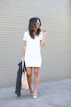 A simple shift dress with a leather jacket will never go out of style. Classic date night outfits like this one on Crystalin Marie are always good to have in your back pocket for a last-minute invitation to a concert or a happy hour. Choose a dress in your favorite color so you'll feel most confident.