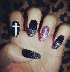 Cross, glitter, and sharp nails = fierce