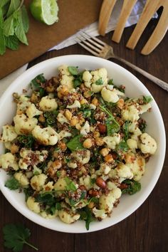 Chock full of roasted cauliflower, roasted chickpeas, all wrapped up in quinoa with a delicious herb-infused jalapeño-lime dressing, this salad is packed with flavor and texture.