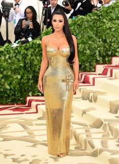 961ce5772f5 Met Gala 2018  Kim Kardashian West in gold Versace - pageantry and  performance on the