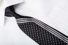 Gorgeous men's Rhinestone necktie handmade from the finest quality silk and designed by top brand name Remizio. Presenting an elegant design with silver vertical stripes on black woven silk, sparkling with an Array of white crystal Rhinestones.