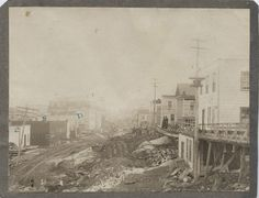 A photograph showing Silver Street in Cobalt. The street is littered with refuse and debris.