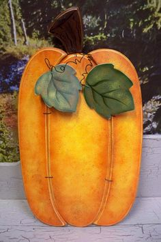 Big Wooden Pumpkin painted on 2 sides, pumpkin on one side and Jack O Lantern on the other.