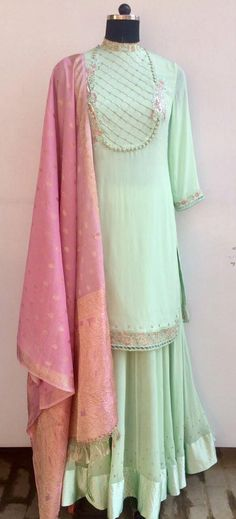 A soothing combination of Mint and Pink coupled together in a full flared Ggt Lehenga with Sateen Border and short Kurti having a pintucked yoke embellished with settled Resham embroidery and pearls and last but not the least intricate cutwork at kurti hem and high neck....Truly Desirable...All by AVEN #lehenga #indianensemble #indiandesign #shortkurti #lehengakurta #designerwear #aventhelabel #aven