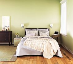 For a serene bedroom retreat go for soothing colors like this light green and lilac combination.