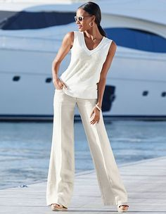 These comfortable linen trousers with fashionably wide legs represent the ultimate in casual elegance and create a wonderfully slim silhouette. Madeleine Fashion, Trends, Pure White, Summer Sale, Trousers, Jumpsuit, Classy, Pure Products, Stylish