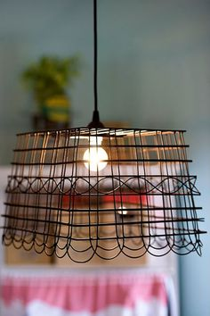 Anthropologie-Inspired Pendant Light : How cool to make a lamp from a wire basket.