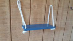 The Swing Rope Shelf is handmade from select pine. This item is 14 long and 5.5 wide. The rope is off white in color made from 100% cotton.  The shelf is hung with 2 boat cleats that are under coated with primer to prevent rust. They are then painted in the color of your choice and seal with polyurethane for protection. The boat cleats are 4 long and come out from the wall approximately 1. The boat cleats are not distressed but can be upon request.  The shelves pictured are saratoga and the…