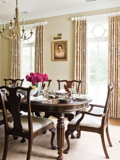 A simple, neutral design makes this dining room versatile enough for a fancy table setting, but laid-back enough for everyday use.