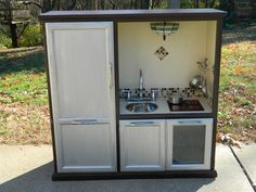 Play Kitchen made from an old Entertainment Center