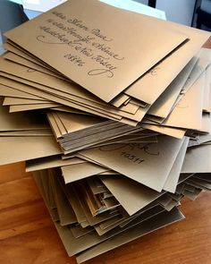 Fancy Script on antique gold shimmer envelopes {Calligraphy by Carrie}