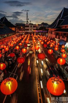 Thousands of red lanterns hang above a street in India. Gallery: Chinese New Year celebrations around the world: Shanghaiist