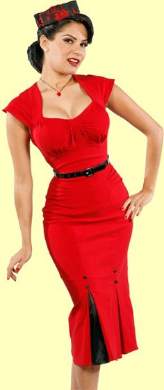 Red hot! This bright red dress has a pleated area at the bust, gathers at the hips, cap sleeves, two front pleats with contrast fabric and faux buttons, black patent belt and back zip. The stretch in the fabric assures a sexy curve hugging fit.