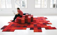 The Ron Arad-designed Do-Lo-Rez Collection, composed of a sofa for Moroso and a rug for nanimarquina, can by used separately or together to create unlimited possibilities of fun. The collection is based on the concept of a pixel and is available in three-color variations: reds, blues, and greys.