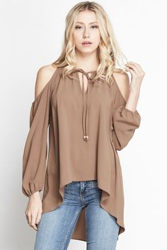 Details Make room for this essential high low top. It features cold shoulders and key hole opening along the front with front tie closure. Wrist lines are elasticized. Look Fashion, Trendy Fashion, Womens Fashion, Casual Outfits, Cute Outfits, Business Outfits, New Wardrobe, Blouse Designs, Spring Summer Fashion