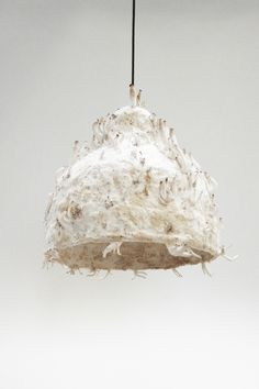 MYX  The lamps consist of plant fibre and mushroom-mycelium. The lamp is grown into shape during a period of 2-3 weeks, where the mushroom mycelium grows together the plant fibres into a flexible and soft living textile. After 2 weeks you can harvest the healthy Oyster mushrooms. The waste product 'shaped as a lamp' can then be dried and used as a lightweight material, that is both organic, compostable and sustainable.