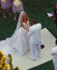 Kendra Wilkinson Photos Photos - Playboy bunny Kendra Wilkinson marries football star Hank Baskett at the Playboy mansion in Beverly Hills, CA.  About 500 guests were in attendance for the Sunset ceremony including Playboy founder Hugh Hefner and his girlfriends, and famous 'Girls Next Door' Bridget Marquardt and Holly Madison. - Kendra Wilkinson Wedding At Playboy Mansion