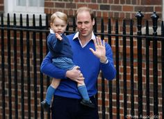 Prince George waves as he is taken into the Lindo Wing by The Duke of Cambridge to meet his little sister