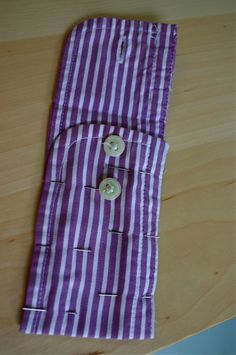 Cut off the Cuff of a button up shirt, sew sides - Viola, a little pouch.