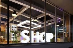 Traditional branding is conspicuously absent; the biggest sign in the window just says 'Shop'.