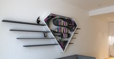 Bookshelves Shaped Like Superhero Logos Add a Special Flair to Any Secret Lair - My Modern Met