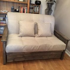 Aylesbury wooden futon style sofa bed.