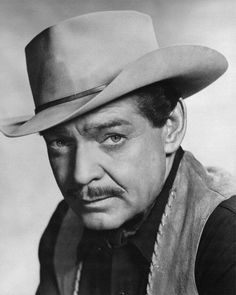 """Clark Gable in a publicity photo for """"The Tall Men"""", 1955."""