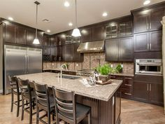 love the dark cabinets and matching pulls for cabinets and drawers