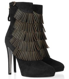 Wear these Sergio Rossi boots with either jeans or a minidress for a guaranteed va va voom result. Was: $1,305 Now only: $392 Buy it here.