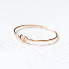 MADE TO ORDER - One Tiny Memory Knot - Knotted Thread of Rose Gold Ring - Stacking Ring - Delicate Jewelry - Memory Ring. $9.50, via Etsy.