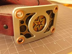 Micah Hallock: Six Pointed Star/ Aluminum/ Copper Rivet Belt Buckle. Belt Buckles, Copper, Stars, Metal, Belt Buckle, Metals, Star, Brass