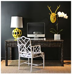 Sally Wheat Chic office space with bold black walls paint color, white faux bamboo chair, Kenneth Wingard Yellow Truffault Lamp, ornate desk and orchid. Black Painted Walls, Black Walls, Charcoal Walls, Sillas Chippendale, Wall Paint Colors, Office Chic, Office Style, My Living Room, Wonderwall