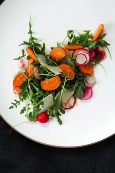 greens, herbs, slivered carrots and radishes